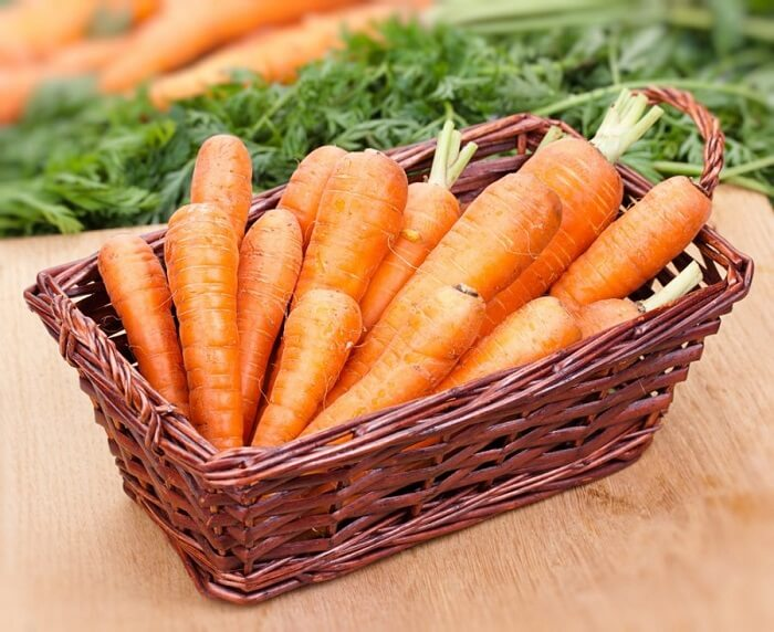 Basket with carrots in it