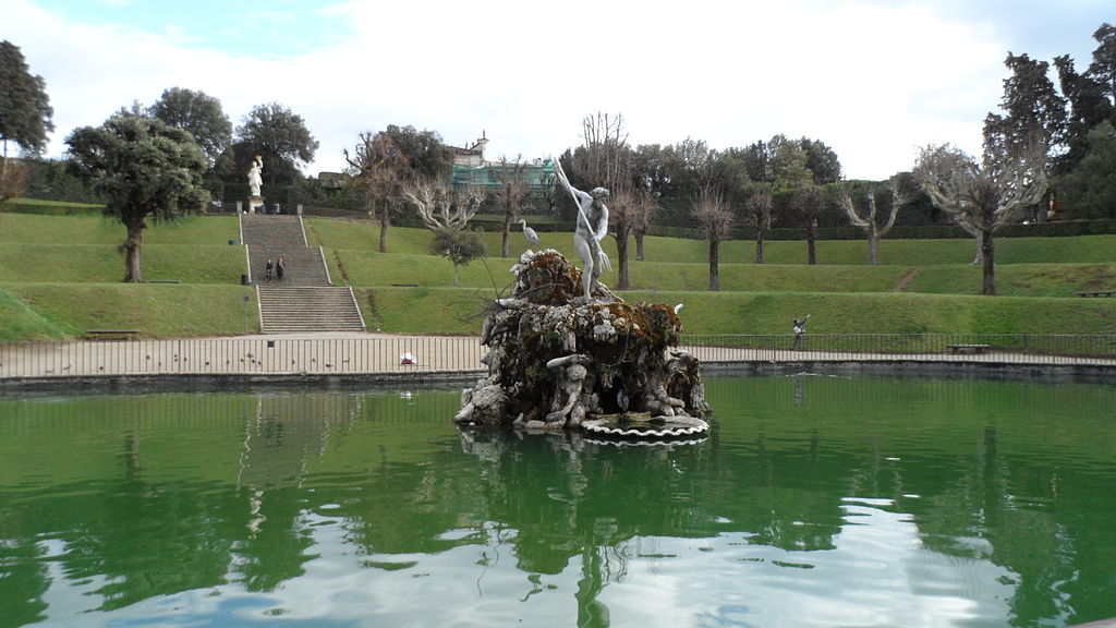 Fountain in the middle of a pond at an Italian Garden in Italy